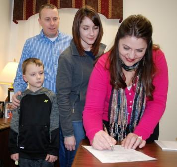 Charlotte Goddard signs candidacy papers. Photo by Berry Craig