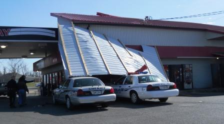 Ouch! Convenient store roof collapses on police cars