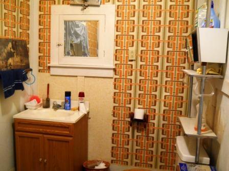 The bathroom as we found it. Tiny. depressing.