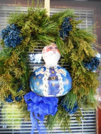A live wreath from Katie Beck and a gourd Santa from Pinke Spencer