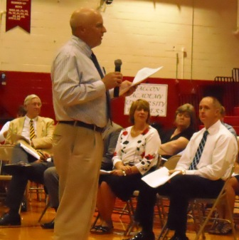 Supt. Kenny Wilson, standing, seated l to r: Dr. Jack Rose, Dianne Owen, Casey Henderson