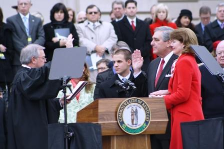 Lt. Gov. Jerry Abramson and wife Madelyn as Chief Justice Minter administers oath of office