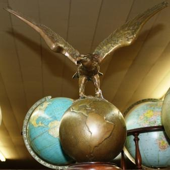 brass eagle on globe