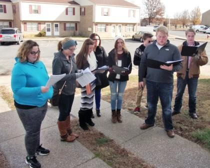 Graves County High School Chamber Choir members sing Christmas carols to tenants of Mayfield Plaza Apartments