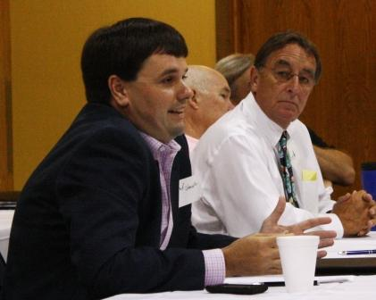 Chad Chancellor makes a point while Rep. Fred Nesler looks on