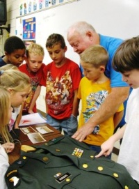Wingo student brings grandfather to show and tell about war experiences on Veterans' Day