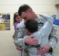 Soldier's homecoming surprises children