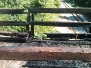 Arson suspected in bridge fire