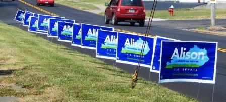 Grimes Outguns McConnell in Road Signs