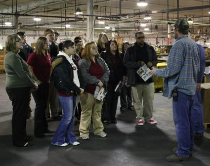 Students are briefed during factory tour