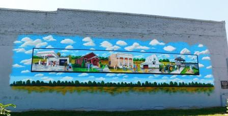 New mural: family, faith, farming and freedom goes up in Clinton