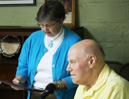 Historical Society Chair LaDonna Lathem presents plaque to John Kelly Ross