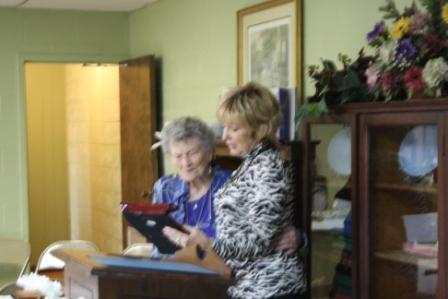 Poet Sheri Roberts presents Dorothy Nell Harper with Jackson Purchase Poet Laureate award